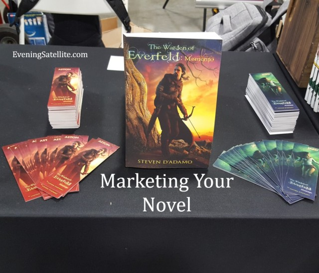 Title card for Marketing Your Novel, photo from AwesomeCon 2019 table, The Warden of Everfeld: Memento fantasy novel, Steve D'Adamo